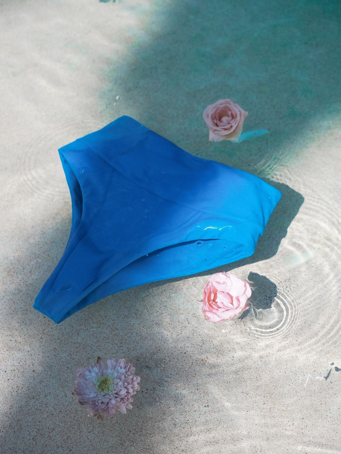 a person lying on a blue surface