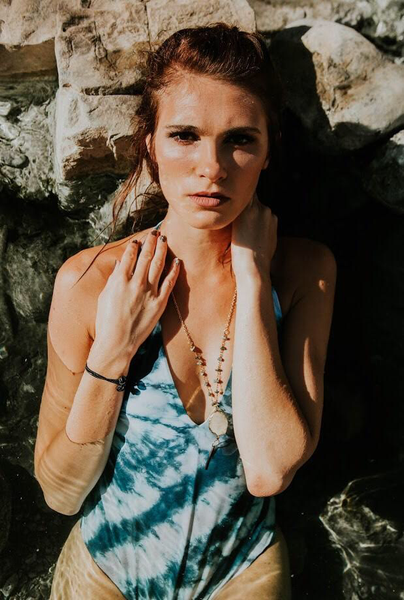 Breylan Webb wearing the Shannon Quartz Druzy (Gold Bar) Necklace.
