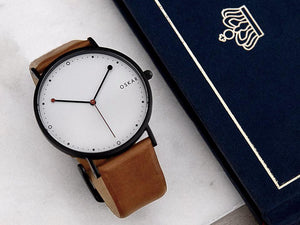 Black and Red OSKAR wrist watch with light brown leather strap and 42mm dial