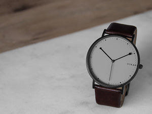 Black and grey Danish design wrist watch from OSKAR Watches with dark brown leather strap and black stainless steel case
