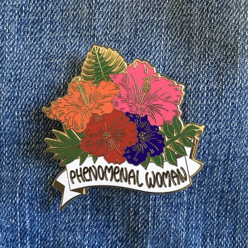 phenomenal woman hibiscus pin on a denim jacket