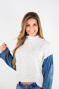 DISTRESSED KNIT SWEATER WITH DENIM SLEEVES