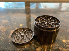 the top chamber of a metal grinder is where you stuff your buds and push down on the magnetic top and twist to grind up weed