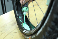 Squeeze Slime's Premium Tubeless Sealant into Your Tubeless Tire