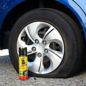 Fix-a-Flat 16 oz #S60420 Can Next to Tire