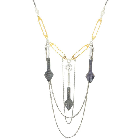 silver and gold statement necklace from British jewellery brand Comfort Station