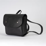 side view of black leather rucksack with silver popper fasteners - IndependentBoutique.com