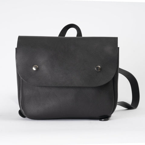 black leather rucksack with silver popper fasteners - IndependentBoutique.com