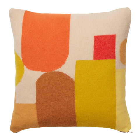 yellow, orange, brown and red geometric knitted cushion by Donna Wilson
