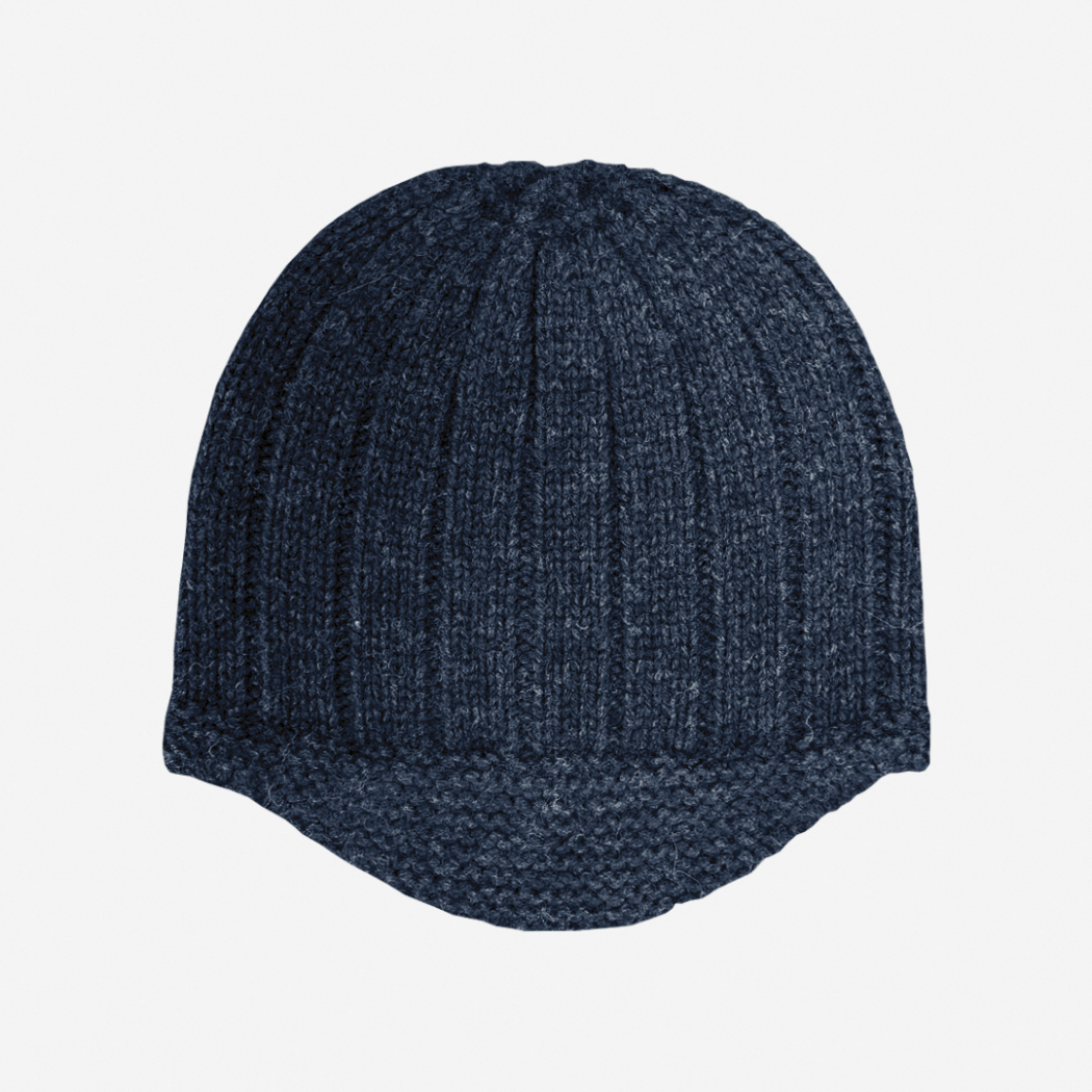 hat in navy blue, machine knitted in a riding hat style.