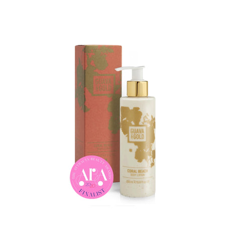 coral and gold printed bottle and box of body lotion by Guava and Gold