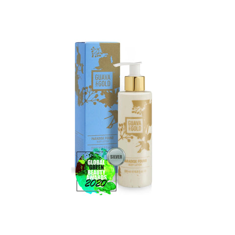 blue and gold printed bottle and box of body lotion by Guava and Gold