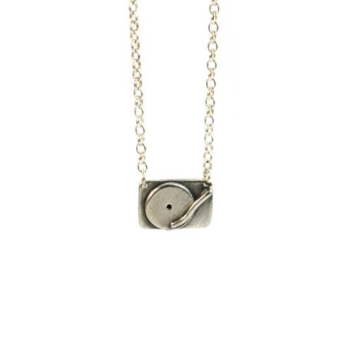Solid silver technics turntable pendant by Bug | IndependentBoutique.com