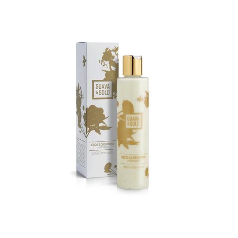 white and gold printed bottle and box of conditioner by Guava and Gold