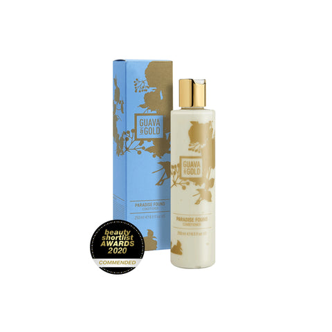 blue and gold printed bottle and box of conditioner by Guava and Gold