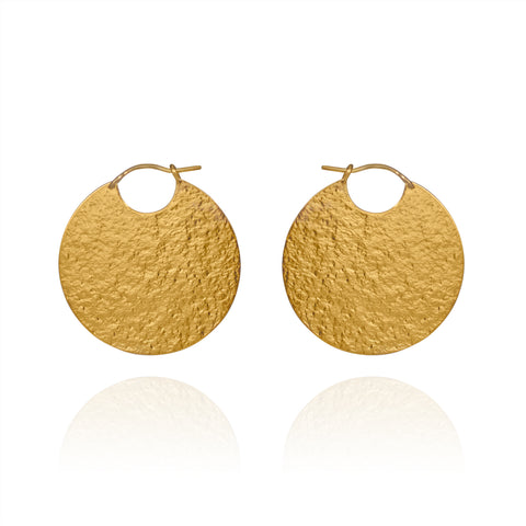 Large gold disc hoop style earrings with textured finish.