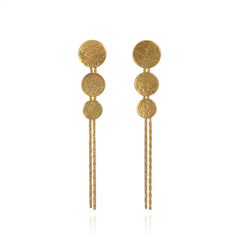 Gold triple disc drop earrings by British jewellery designer Cara Tonkin