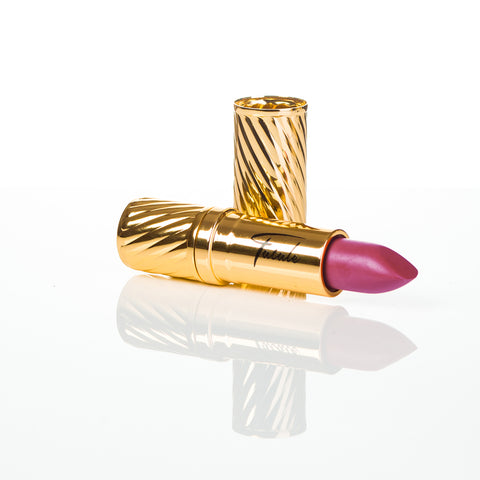 rose pink lipstick in gold embossed tube with black Fatale logo on side at IndependentBoutique.com