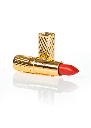 coral lipstick in gold embossed tube with black Fatale logo on side at IndependentBoutique.com