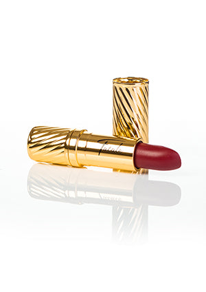 red lipstick in gold embossed tube with black Fatale logo on side at IndependentBoutique.com