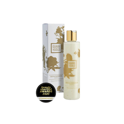white and gold printed bottle and box of shampoo by Guava and Gold