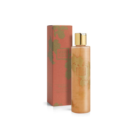 coral and gold printed bottle and box of shampoo by Guava and Gold