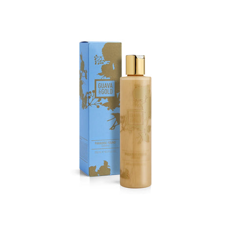 blue and gold printed bottle and box of shampoo by Guava and Gold