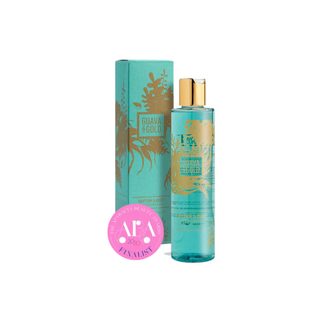 turquoise and gold printed bottle and box of shower gel by Guava and Gold