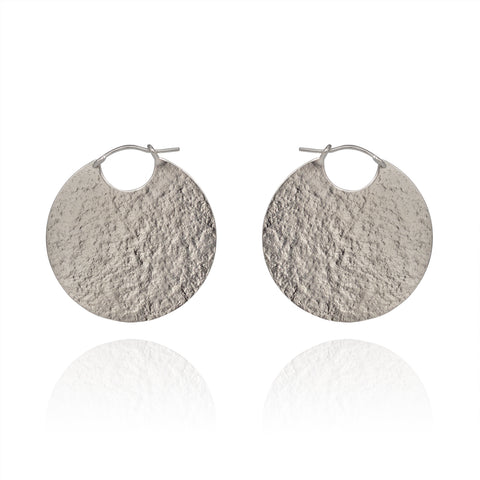 Large silver disc hoop textured earrings.