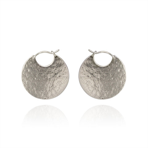 Silver disc hoop textured earrings.