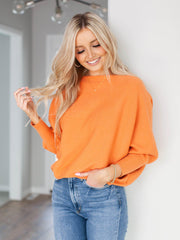 ribbed orange dolman sweater