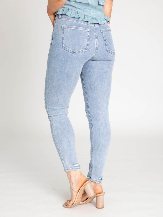 light wash knee destruct denim