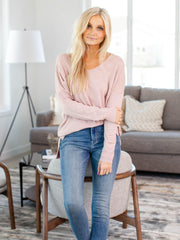 light pink v-neck sweater