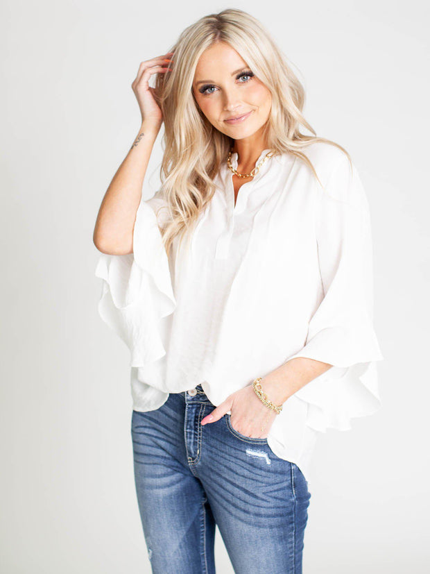 white ruffle sleeve top