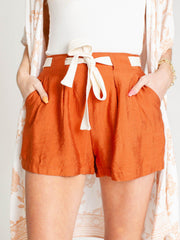 belted rust shorts