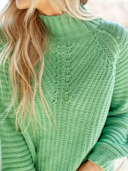 green mock neck sweater