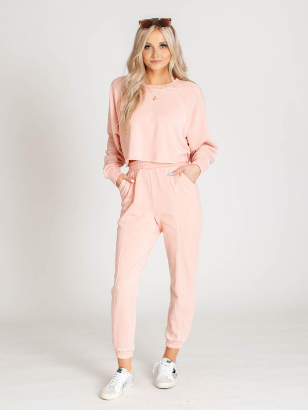 rose colored sweats