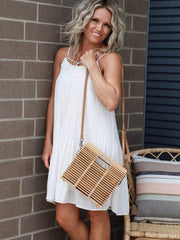 flowy white pleated dress