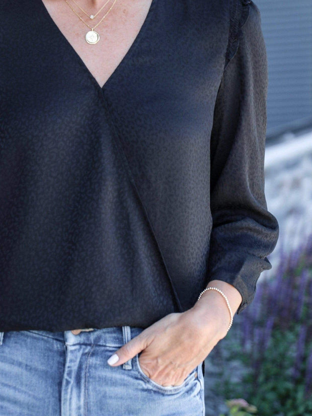 ruffle wrap front black top