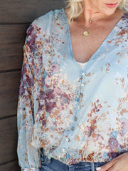 light blue floral blouse