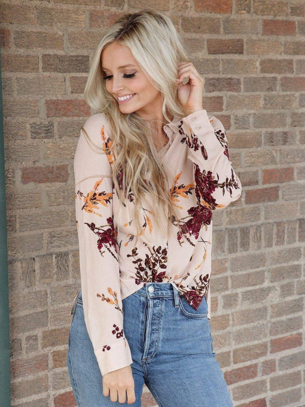light pink floral blouse