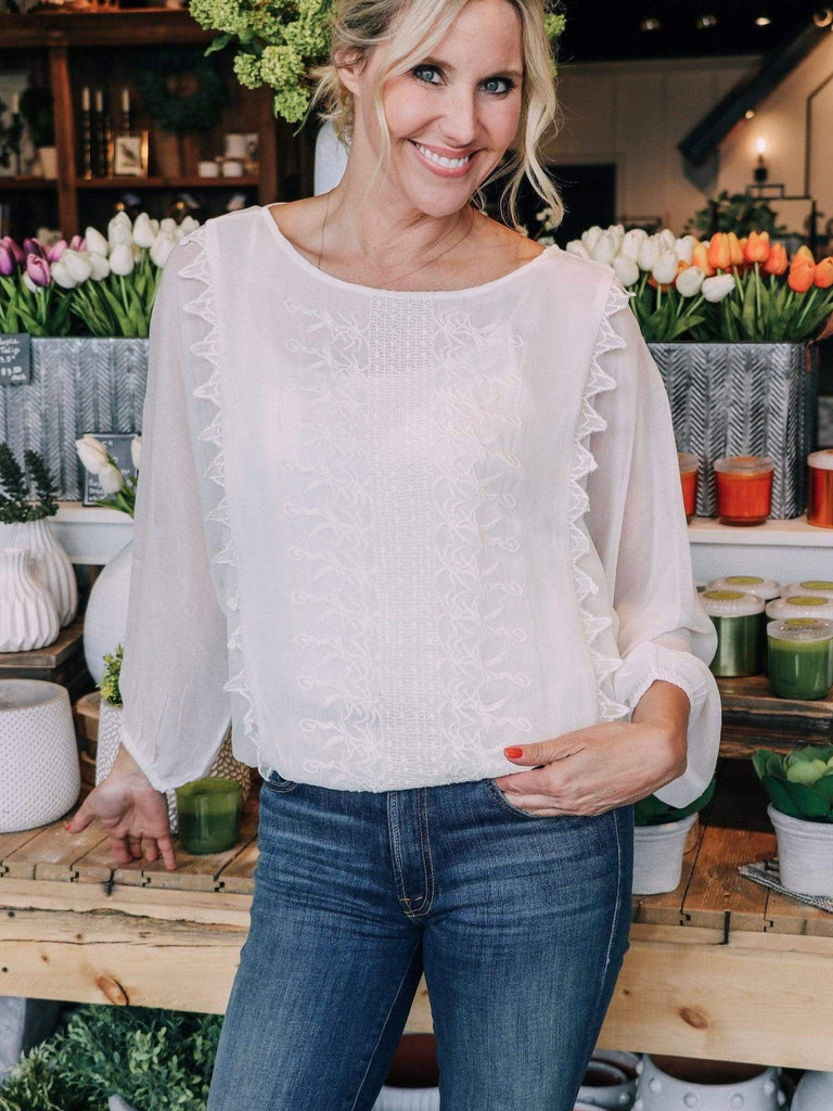embroidered ivory blouse