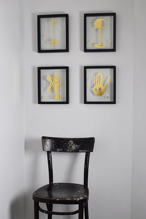 black floating frames with glass gilded images of bauhaus designs