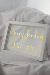 white floating frame with gilded glass, new born gold sign