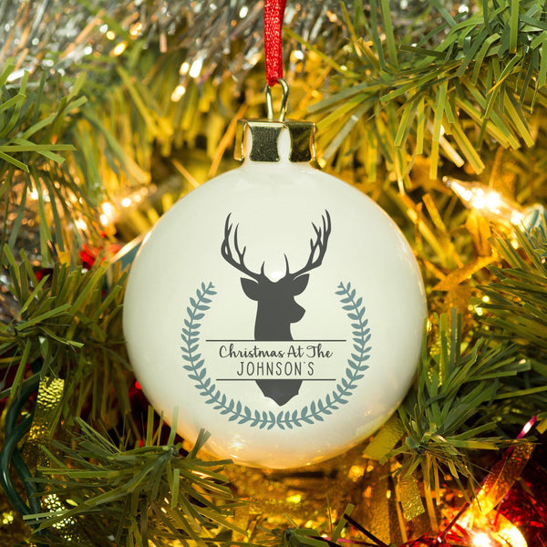 Contemporary Wreath Christmas Bauble With A Stags Head Above Personalised Text