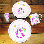 Unicorn Breakfast Set - Colourful Unicorn Decorated Mug, Bowl, Plate And Egg Cup Set With The Recipients Name On A Cloud In Front Of A Rainbow