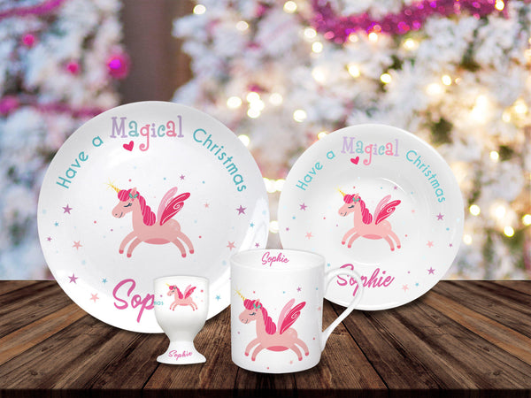 Magical Christmas Breakfast Set Which Consists Of A Mug, Plate, Bowl And Egg Cup, All Items Have A Pink Unicorn And Personalised Name