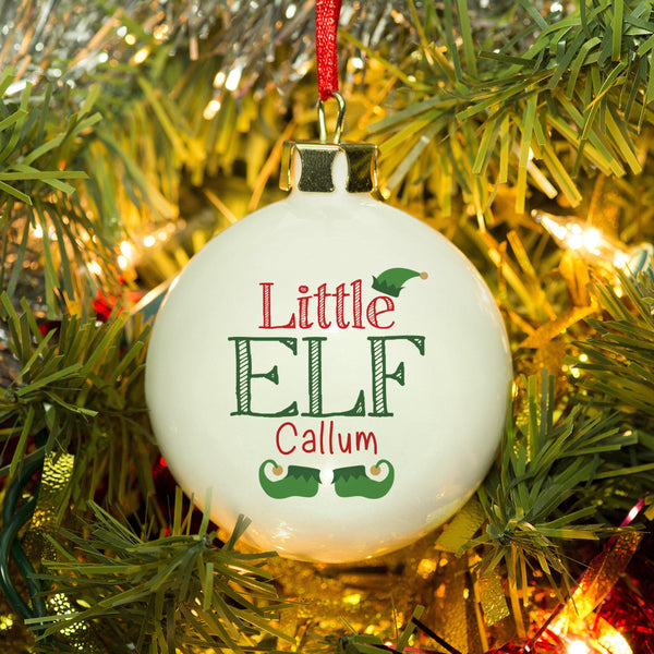 Little Elf Bauble - Little ELF Text With The Recipients Name Below Little ELF Text, The Text Sits Between An Elf Hat And Boots