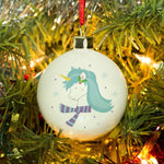 Winter Unicorn Bauble Featuring A Blue Maned Unicorn Wearing A Blue/Purple Scarf With Snow Falling