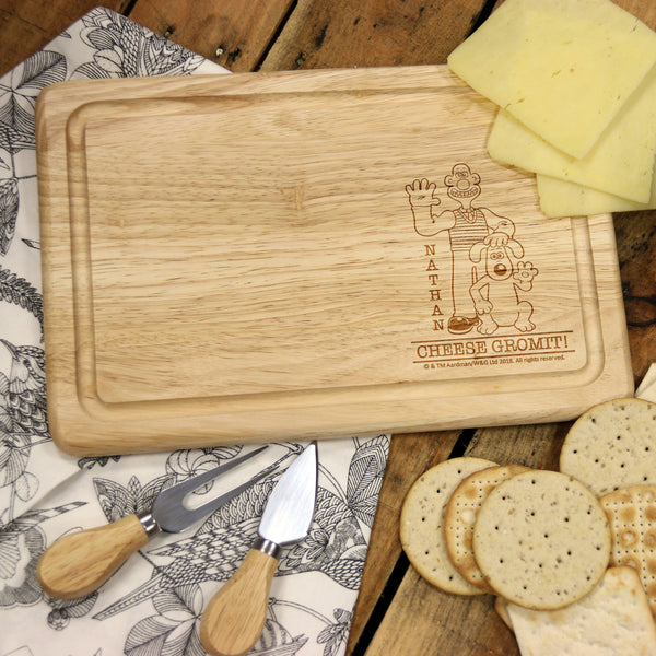 "W & G 'Cheese Gromit' Rectangle Wooden Cheese Board - Picture Of Wallace & Gromit To The Right With The Words ""CHEESE GROMIT!"" Underneath"